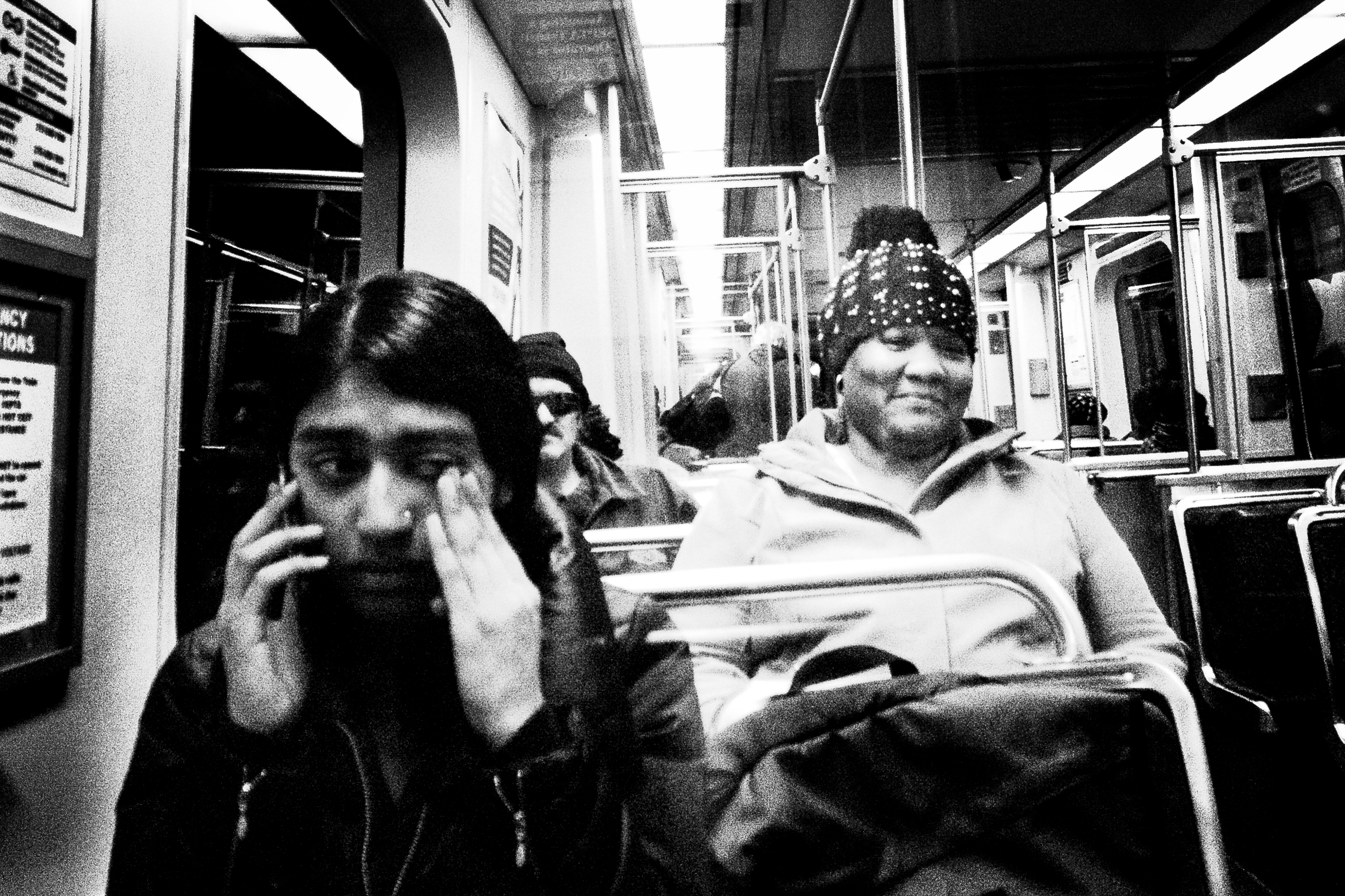 Photograph of two women riding on the subway